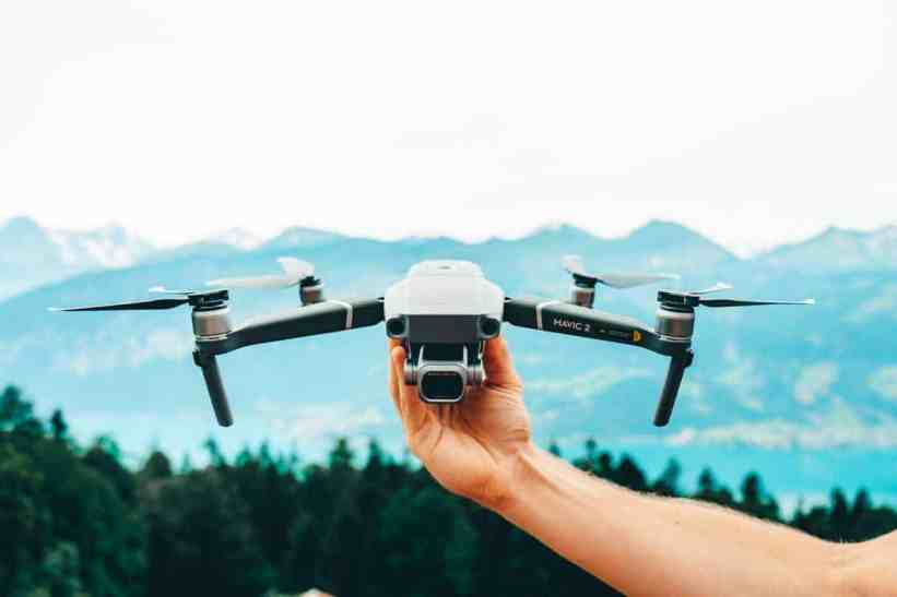 Best drone for travel photography, DJI Mavic 2 Pro, held out above the Swiss alps