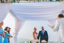 bride and groom from lebanon with the caldera view