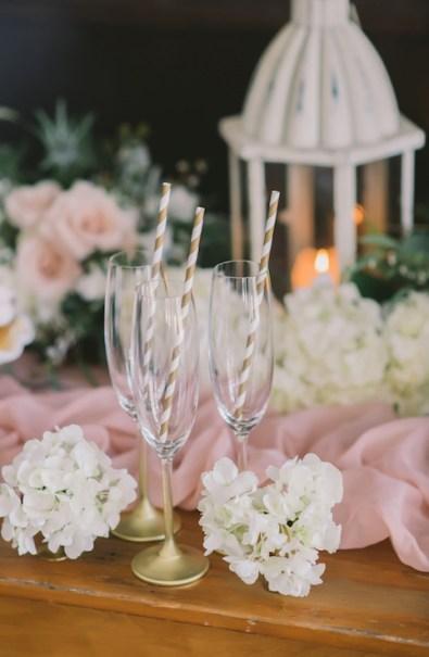 winter-wedding-champagne-flutes-striped-straws-nova-markina-photography