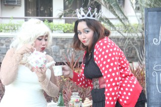 my sisters: Christine as the White Queen and Janice as the Queen of Hearts