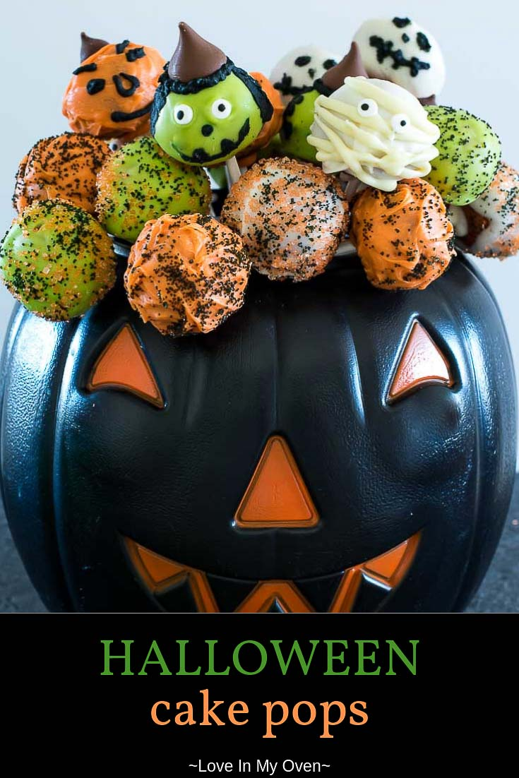 These Halloween cake pops are a fun way to treat your little ghosts and goblins this Halloween! Pumpkin cake pops with a delicious chocolate coating! // halloween cake pops // pumpkin cake pops // halloween themed cake pops