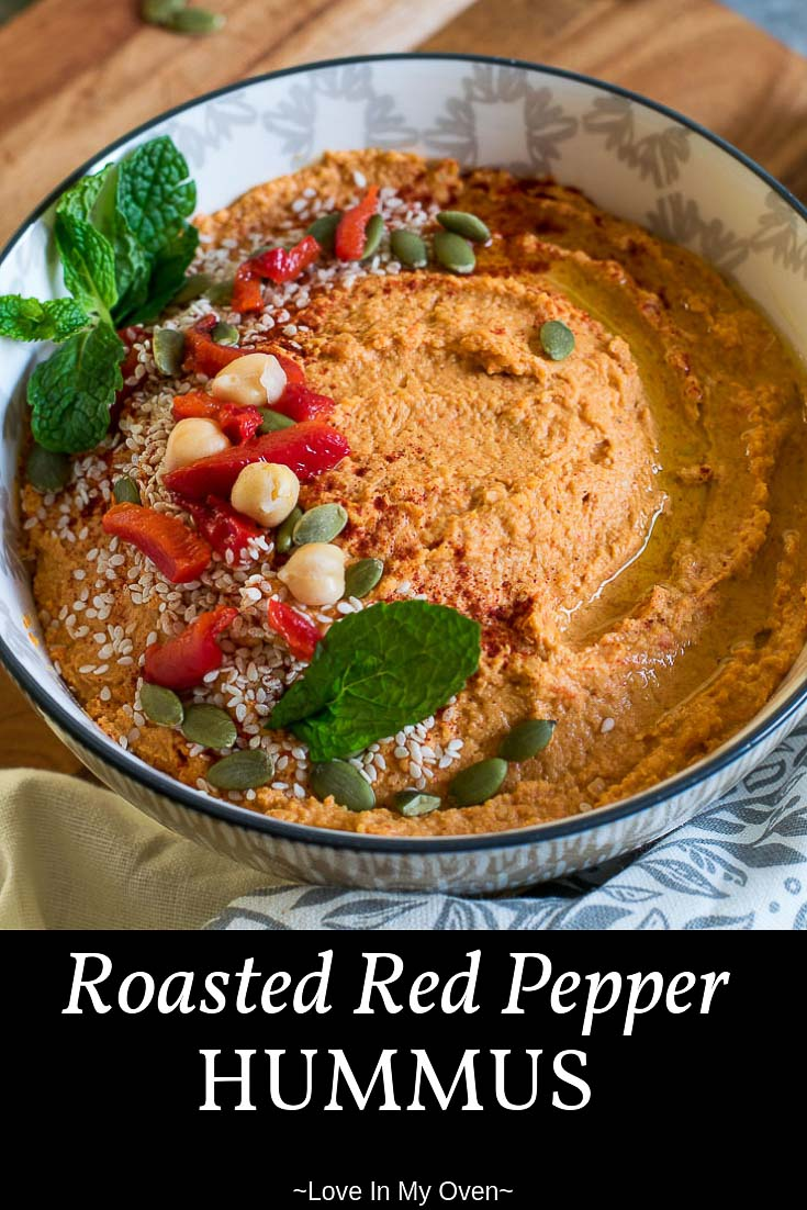 A delicious blend of creamy chickpeas, roasted red pepper and garlic, tahini and spices. Serve it up with crackers or raw veggies for a healthier snack for you and your family #hummus #roastedredpepper #healthysnack #easyrecipe