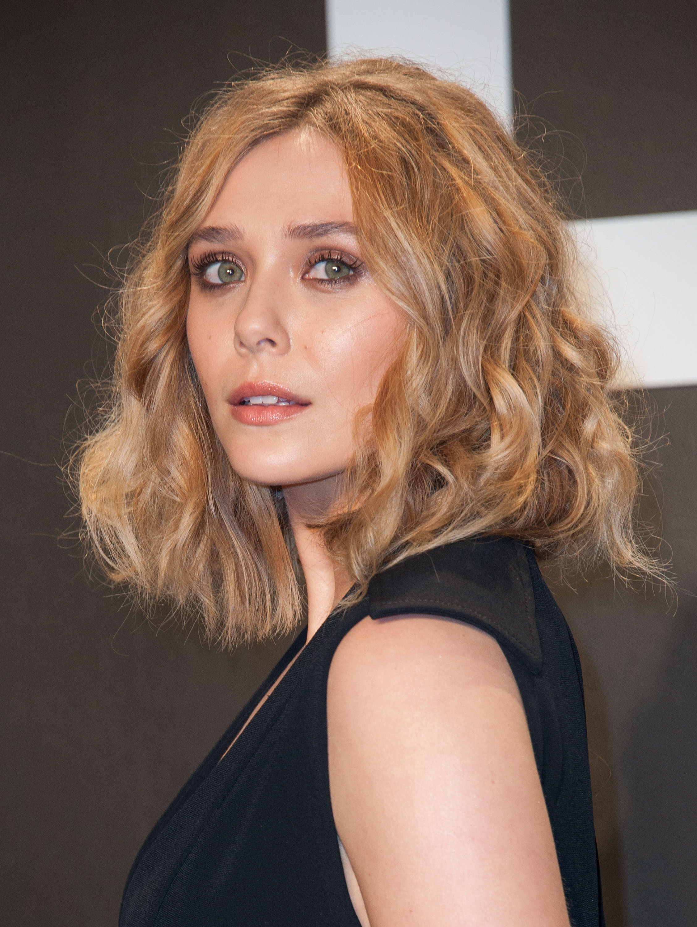Elizabeth Olsen Nails Menswear Trend While Channeling Her