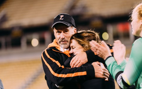 Coach Todd Kelly hugs Lauren Parker