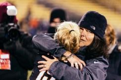Julie Renner hugs Brice Grieshop