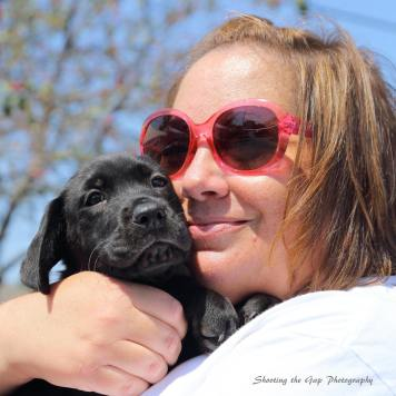 Lynn Stacy Smith of Love Laugh Woof with puppy photo by Shooting the Gap Photography