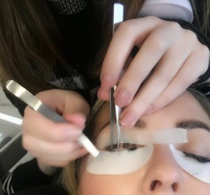 using tape to left my lashes to add my volume to my lashes