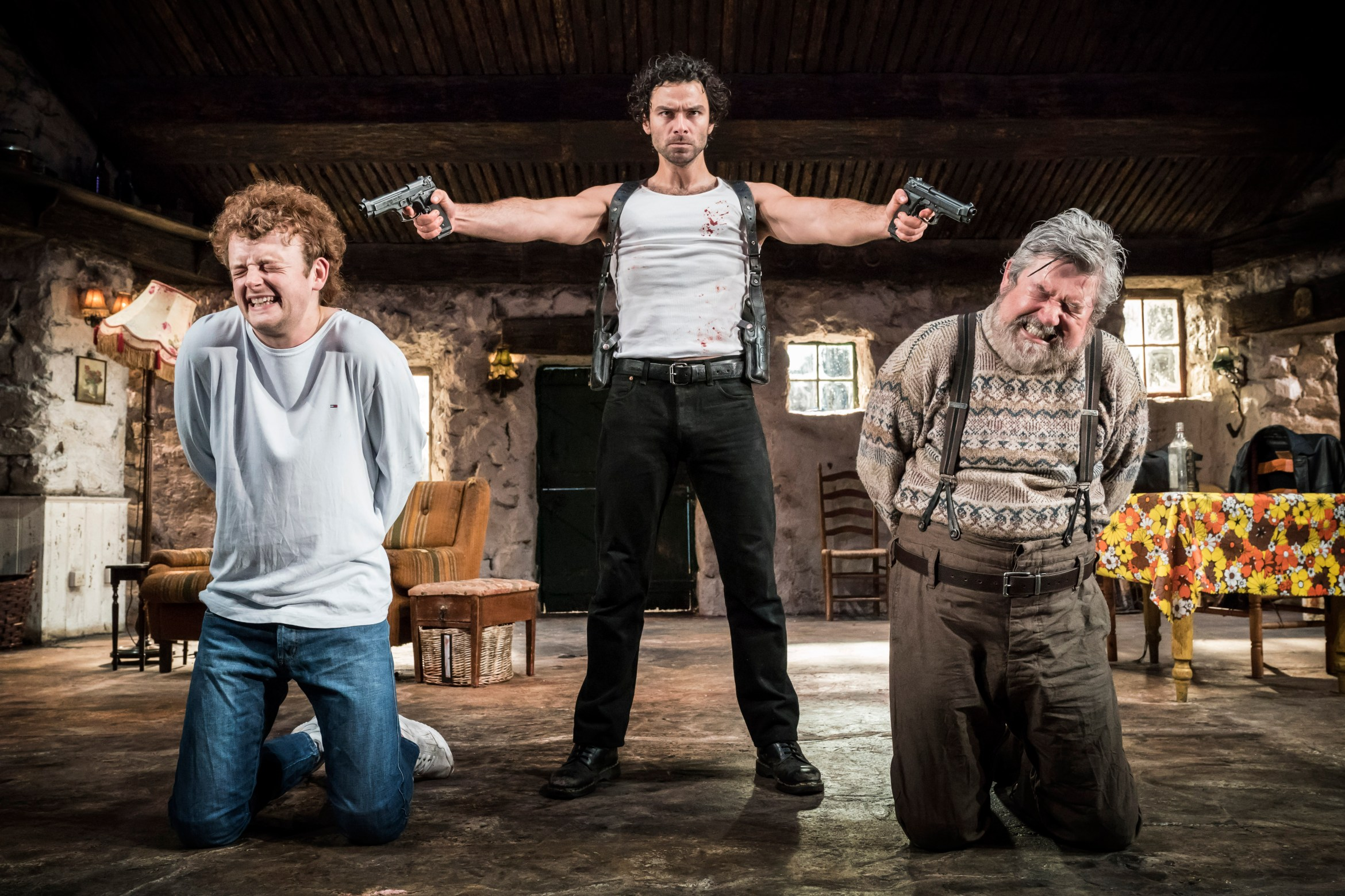 The Lieutenant of Inishmore%2c Noël Coward Theatre. Chris Walley (Davey)%2c Aidan Turner (Padraic) & Denis Conway (Donny) Credit Johan Persson.jpg