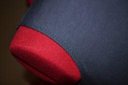 Zigzag stitching encasing invisible elastic , stabilising the arm hole edges