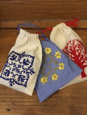 Blue embroidered jewellery pouch