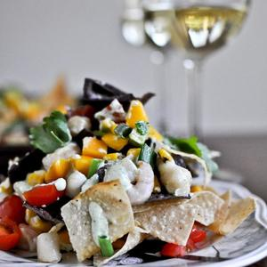 Summertime Seafood Nachos With Grilled Corn + Avocado Cream