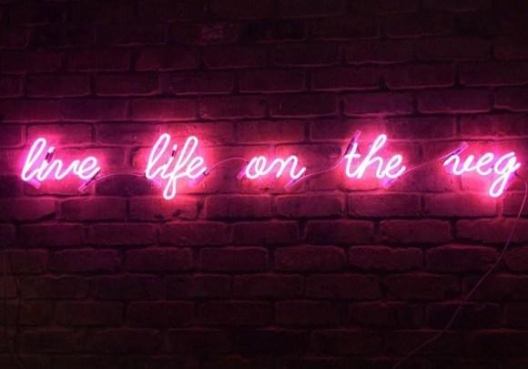 "vegan restaurants Derby, neon sign reads ""live life on the veg"""
