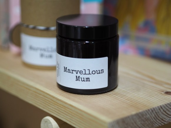 Marvellous Mum candle on shelf. From Design 44 in Derby. One of the lovely local indie brands featured in the Mother's Day gift guide.
