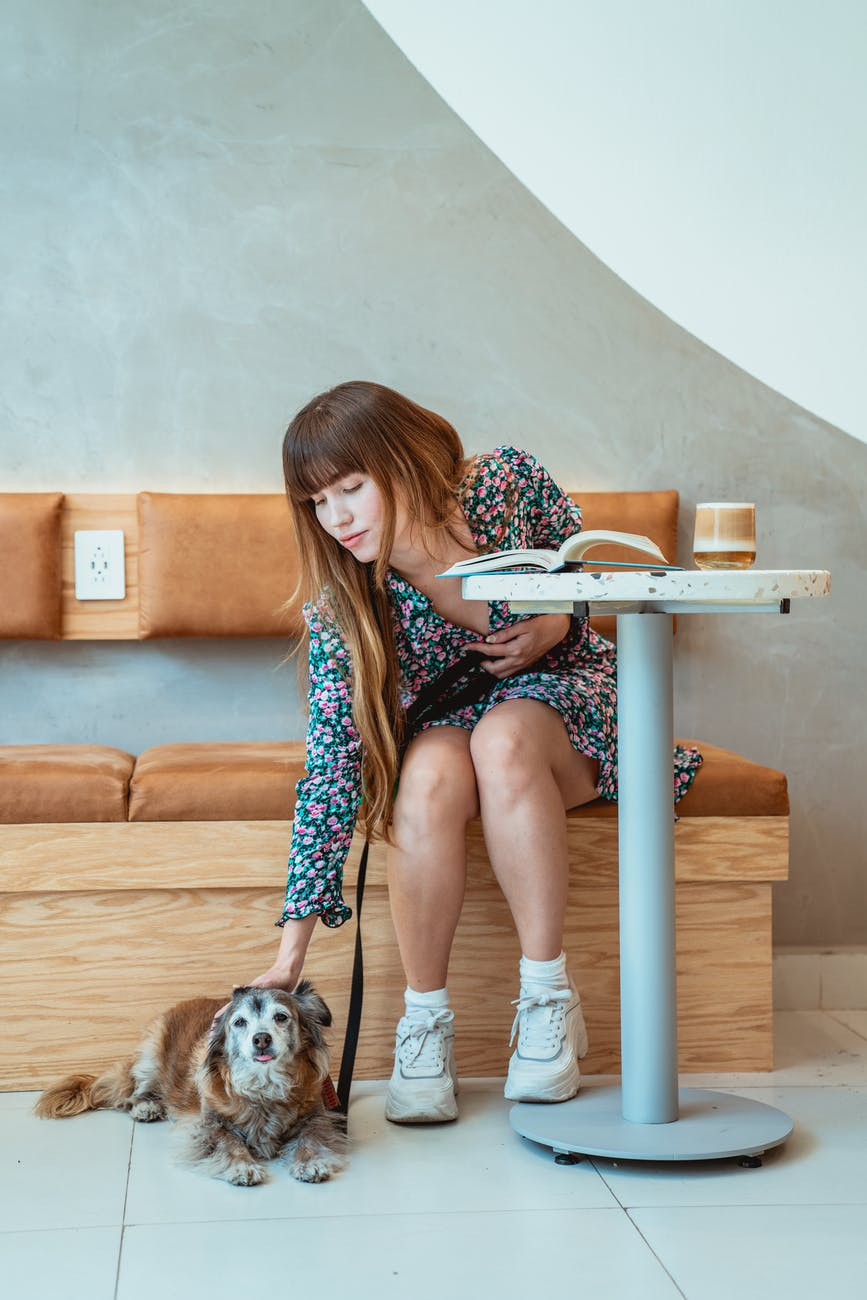 photo of woman petting her dog