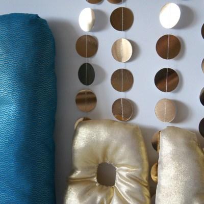 Guirlande en papier de pastilles dorées