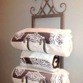 Repurposed wine rack into a towel holder {Love My DIY Home]