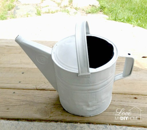 spray painted watering can