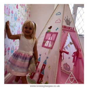 little girl stood next to her princess fairy tale bespoke personalised teepee