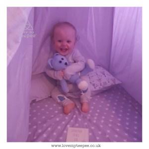cute baby inside his bespoke teepee