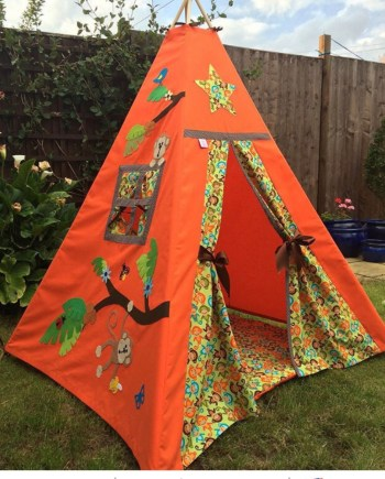 orange teepee decorated side panel with jungle leaves and flowers