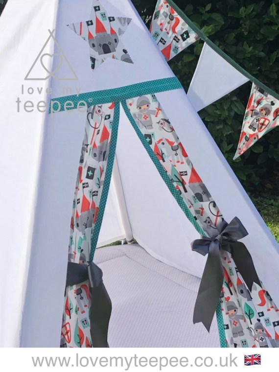 white teepee with knight fabric, grey floor mat and bunting