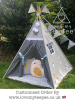 kids grey and white star teepee tent with personalised cushion and mustard bird cushion, floral padded floor mat. decorated with butterflies and pom poms and pole flags.
