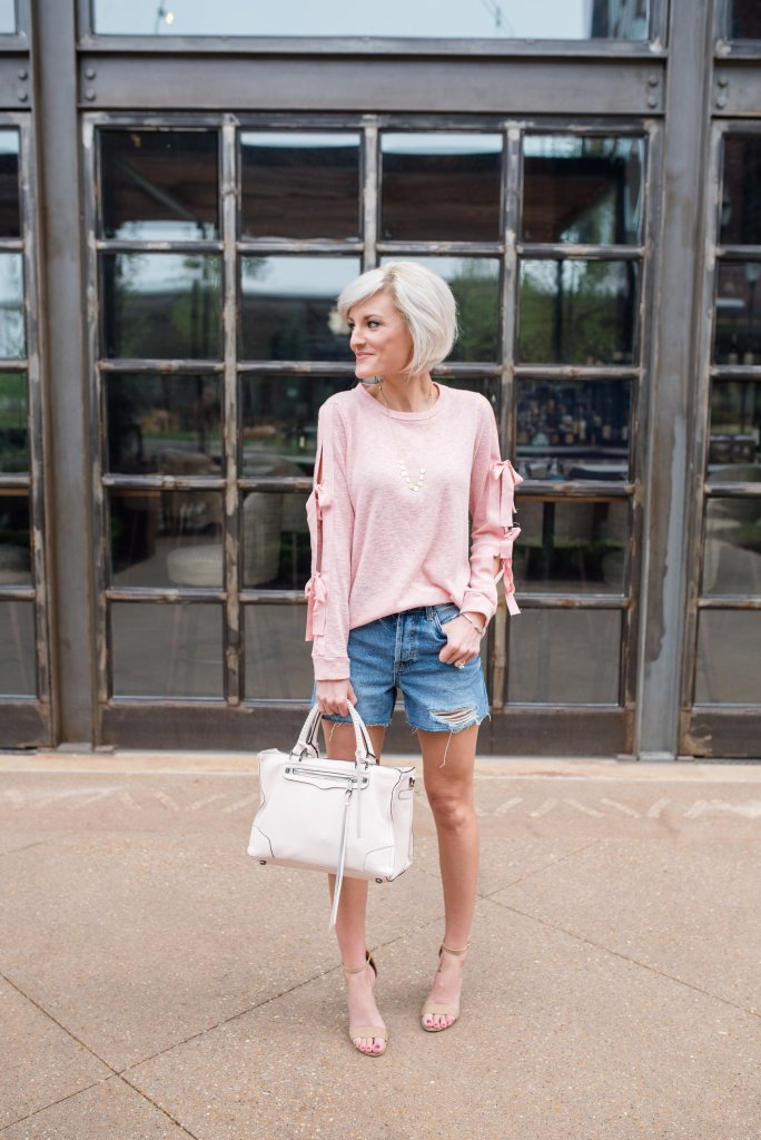 pink bow sleeves, distressed denim shorts