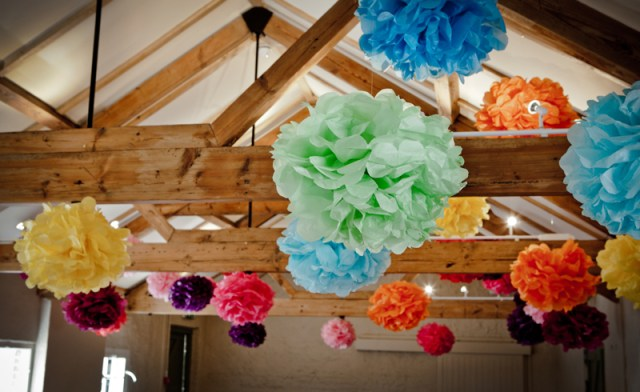 Paper tissue pom-poms at a Sussex wedding