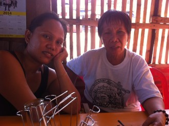 Daisy Tabernilla (62) and with her daughter Chona (35) owner/operators of the Daisy Carinderia. Daiy is so upset and traumatised because this is now the third disaster in less than two years.