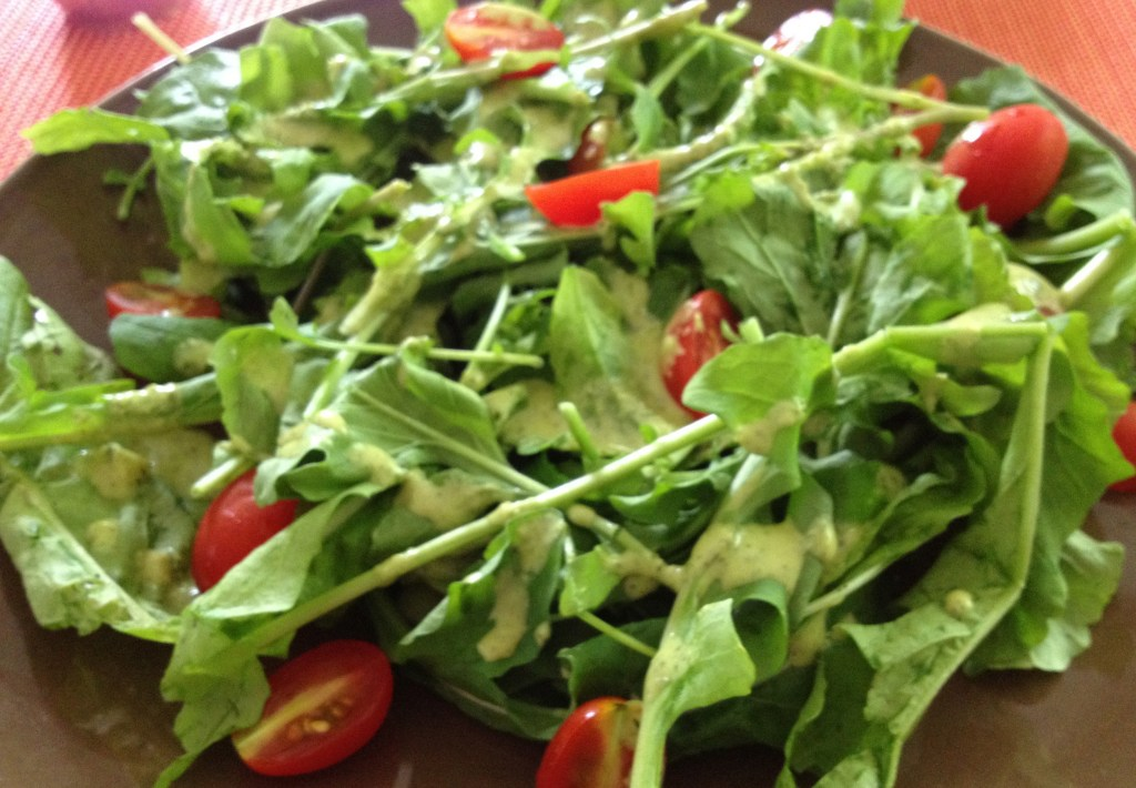 Lemon Anchovy dressing on salad with tomatoes.