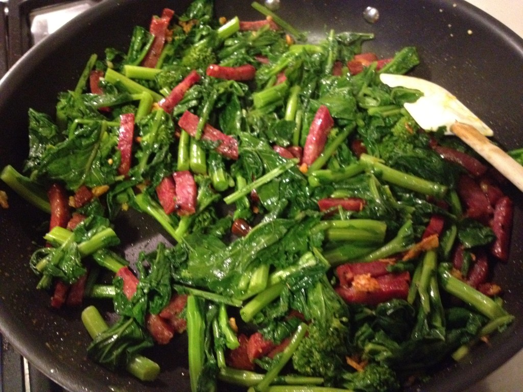 Broccoli rabe, sausage and garlic in a skillet.