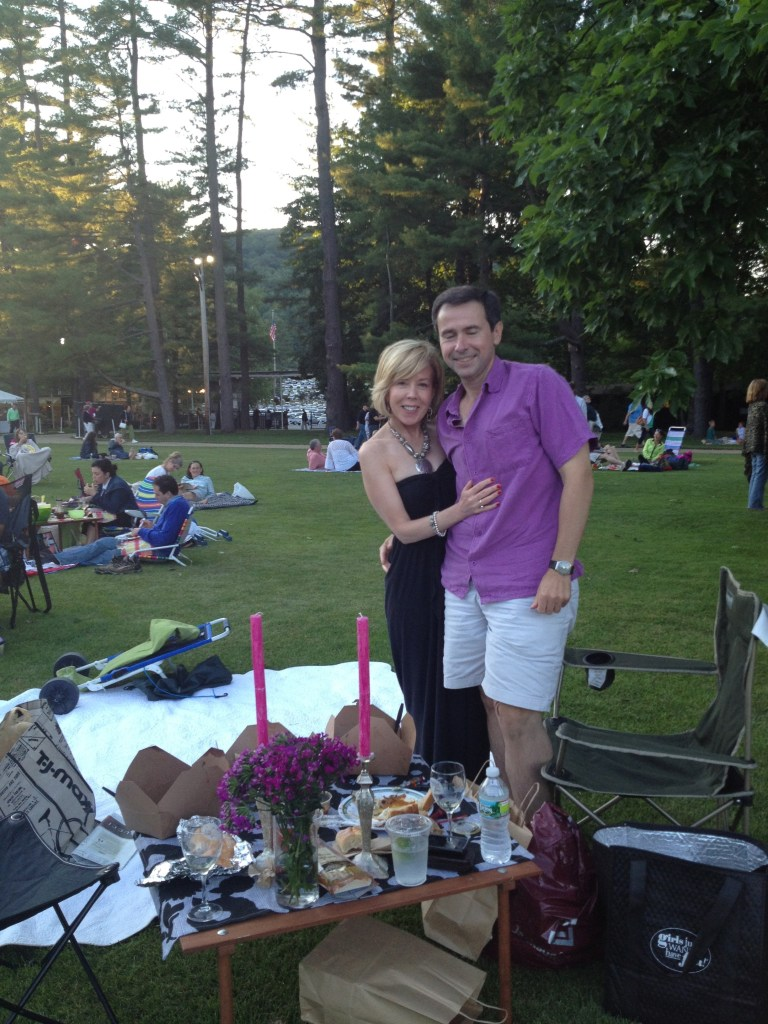 Elegant couple with candlelit picnic dinner at Tanglewood.
