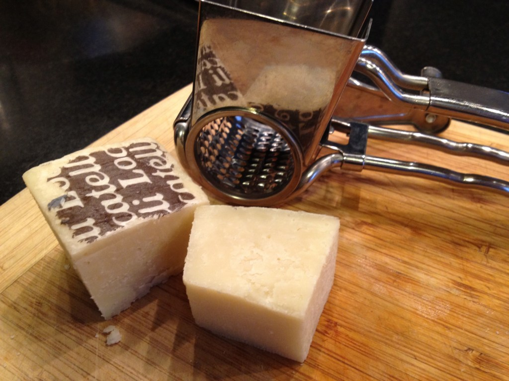 Romano cheese on a wooden cutting board.