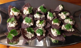 Texas smoked salmon tartare on blue corn chips as an appetizer from Food and Wine magazine.