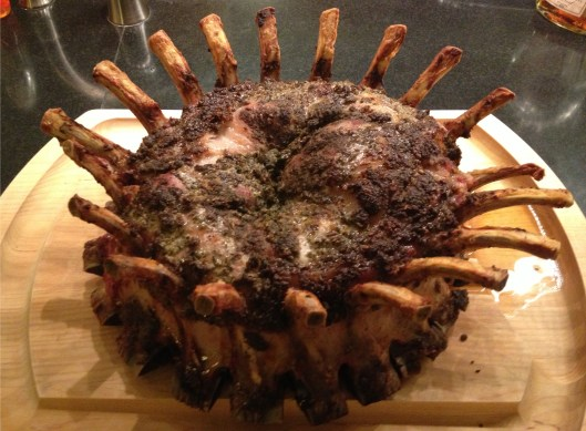 Crown roast of pork with fennel, lemon and garlic paste/marinade.