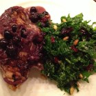 kale salad with sauteed chicken breast in white wine, shallots and blueberries