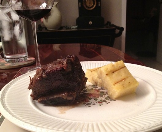 Delicious short ribs with creamy polenta squares on an antique Wedgewood plate.