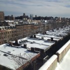 NYC blizzard of 2013 view from a Harlem apartment looking East on landmarked brownstones.