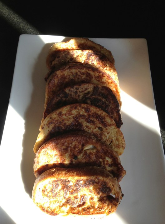 French toast on a platter with the morning sunlight streaming in.