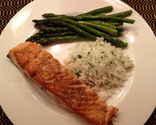 Everyday dinners, roasted salmon, steamed Jasmine rice with parsley and roasted asparagus on a white Wedgewood plate.