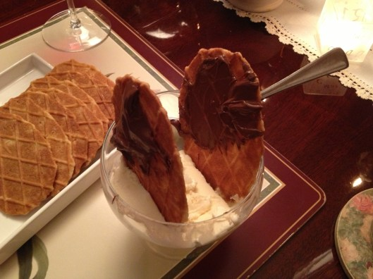 Bowl of vanilla ice cream with Swedish butter cookies spread with Nutella.