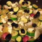 Sauteed zucchini with onions and radishes topped with feta cheese and oil-cured Moroccan olives.
