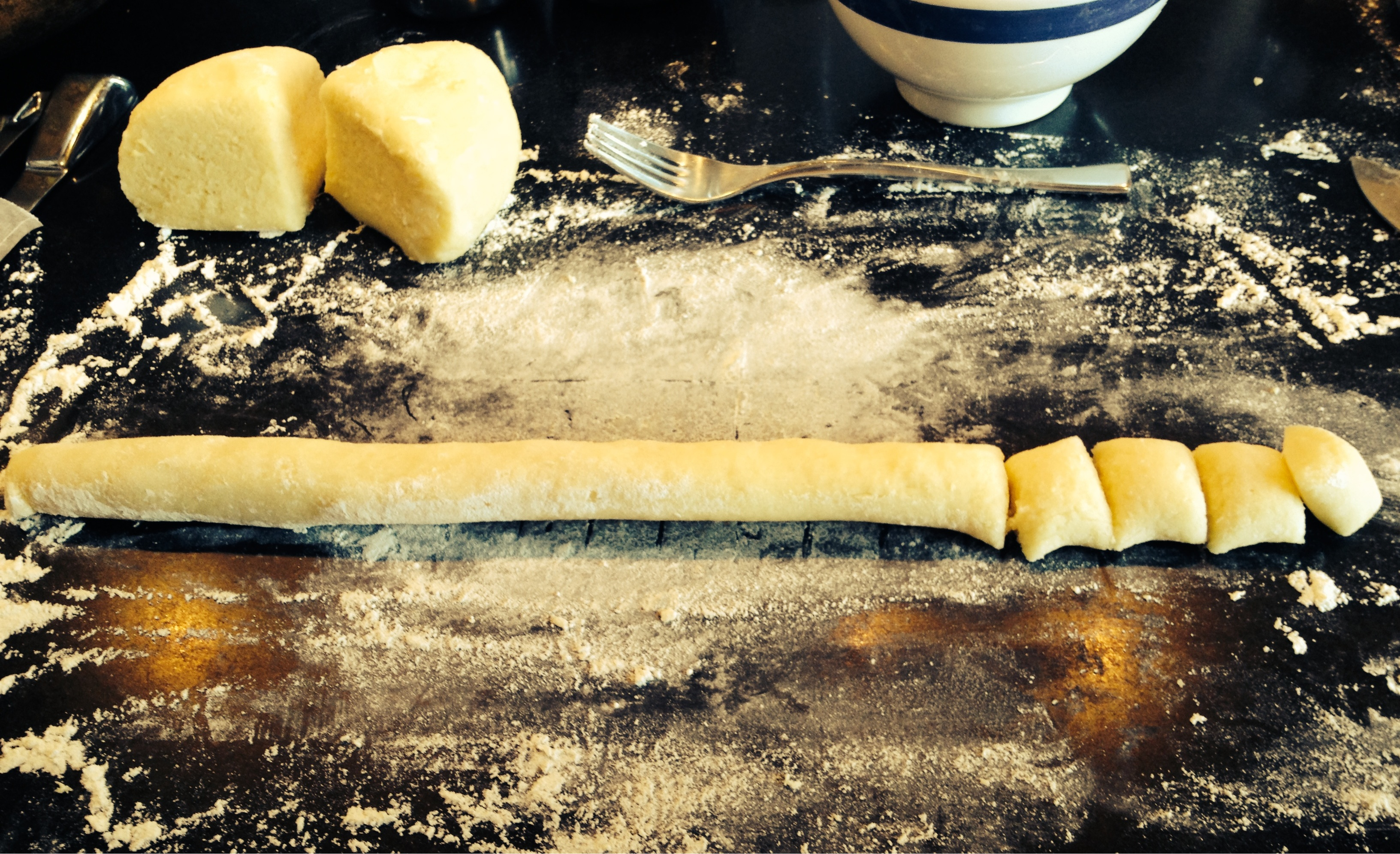 Homemade gnocchi being rolled out.