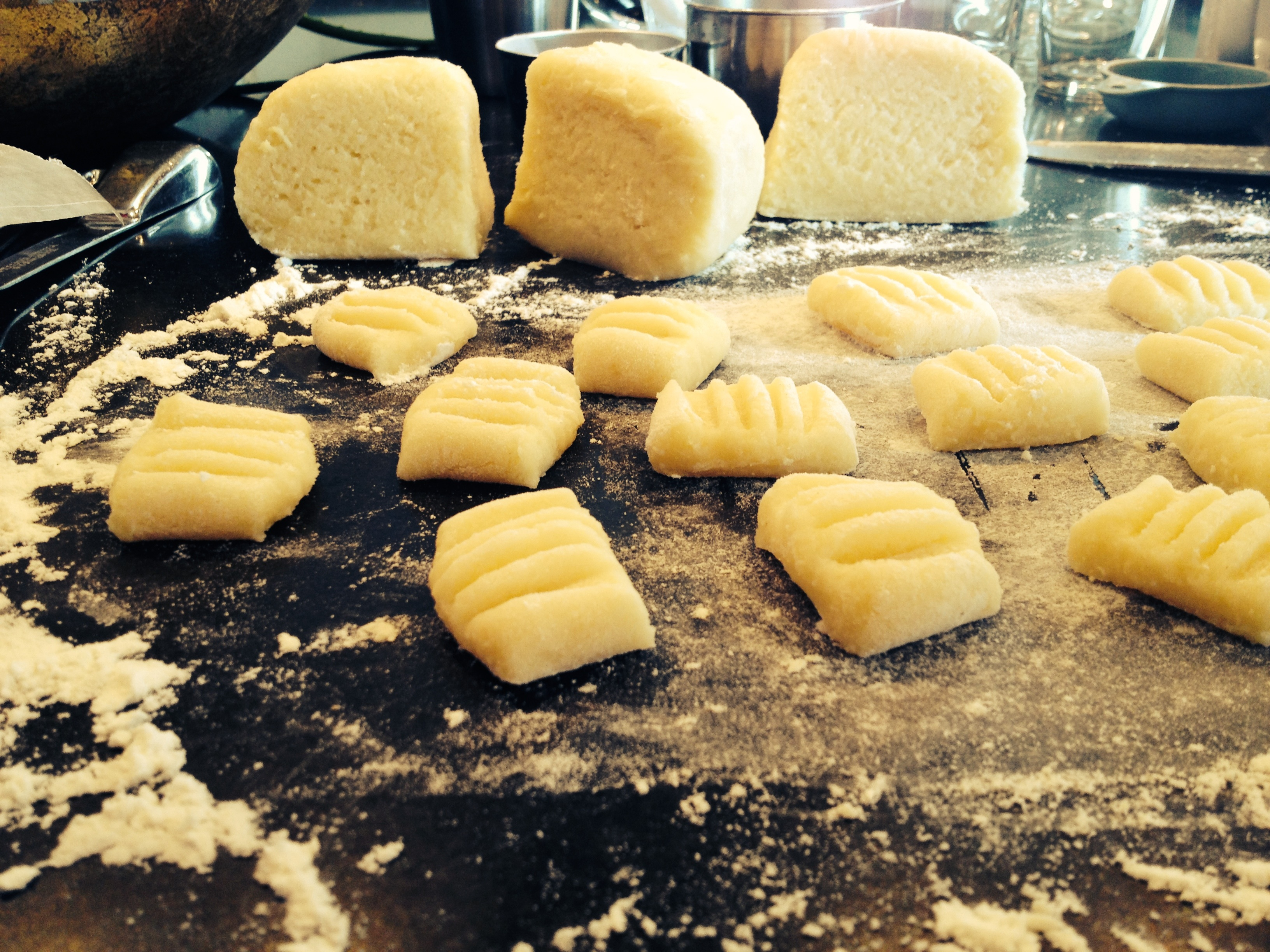Homemade gnocchi being made - delicate little pillows.