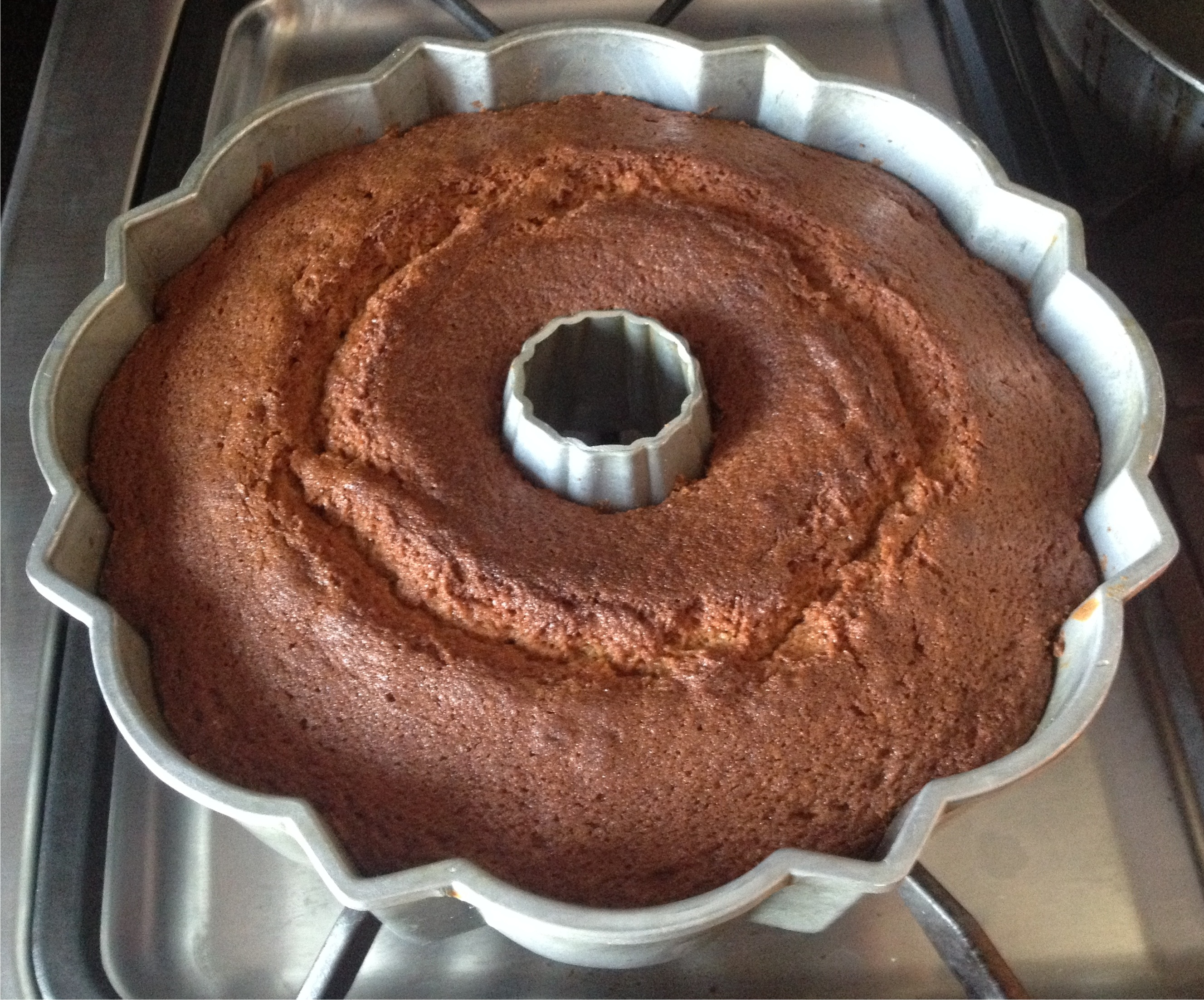 Bruce cost ginger ale spice cake in a bundt pan.