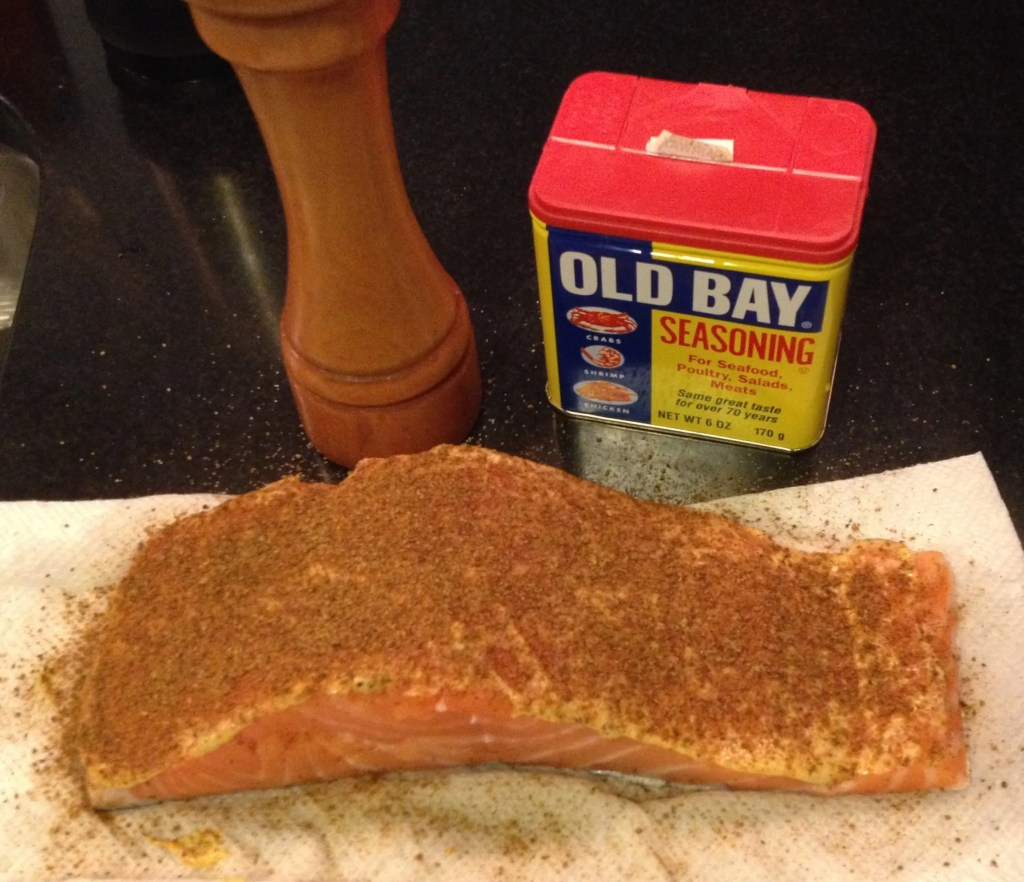 Salmon filet seasoned with Dijon mustard and Old Bay.