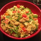 Freekeh salad in a red bowl.