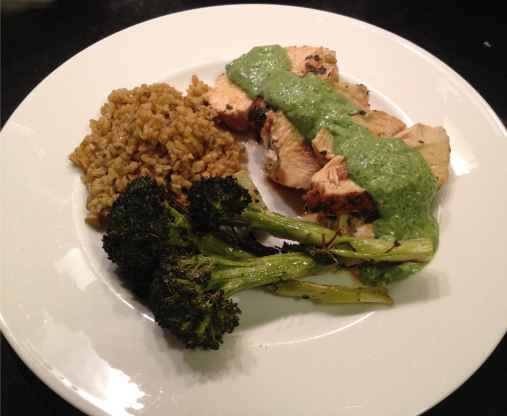 Sorrel sauce on sliced chicken breasts with roasted broccoli and freekeh.