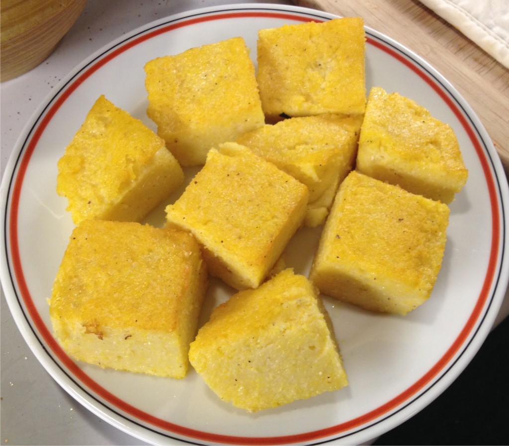 Polenta squares on a plate.