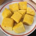 Polenta squares on a plate.